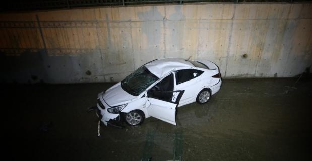 Adana'da otomobil atık su kanalına devrildi