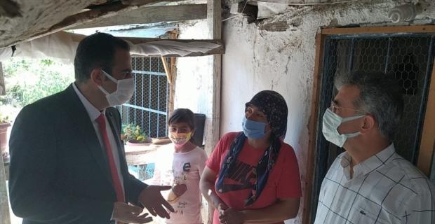 Aile ve Sosyal Hizmetler Bakanlığı Eğitim Yayın Daire Başkanı Sezen'den, Kozan'da sel mağduru ailelere ziyaret